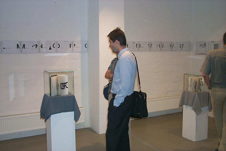 View of the exhibition  THE BOOK (±)SYMMETRY-VIOLATION, Artpool P60, Budapest, 2002 (Curator: györgy Galántai)