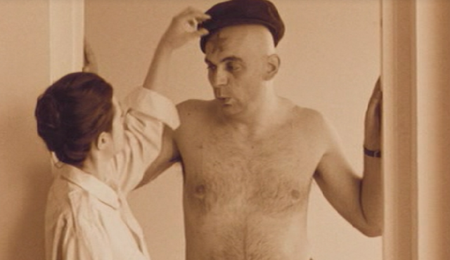 Scene in which the main actor whistles the song 'Lili Marleen' while his girl-friend draws a red star on his forehead and in the background a sovjet speech about Western imperialism can be heard.