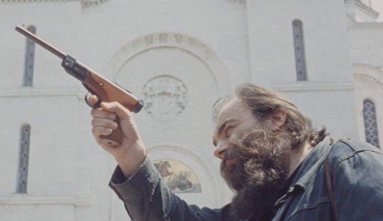 Scene in which the main actor expresses an anti-clerical attitude by pointing a gun in a church where members of the serbian royal family are buried.