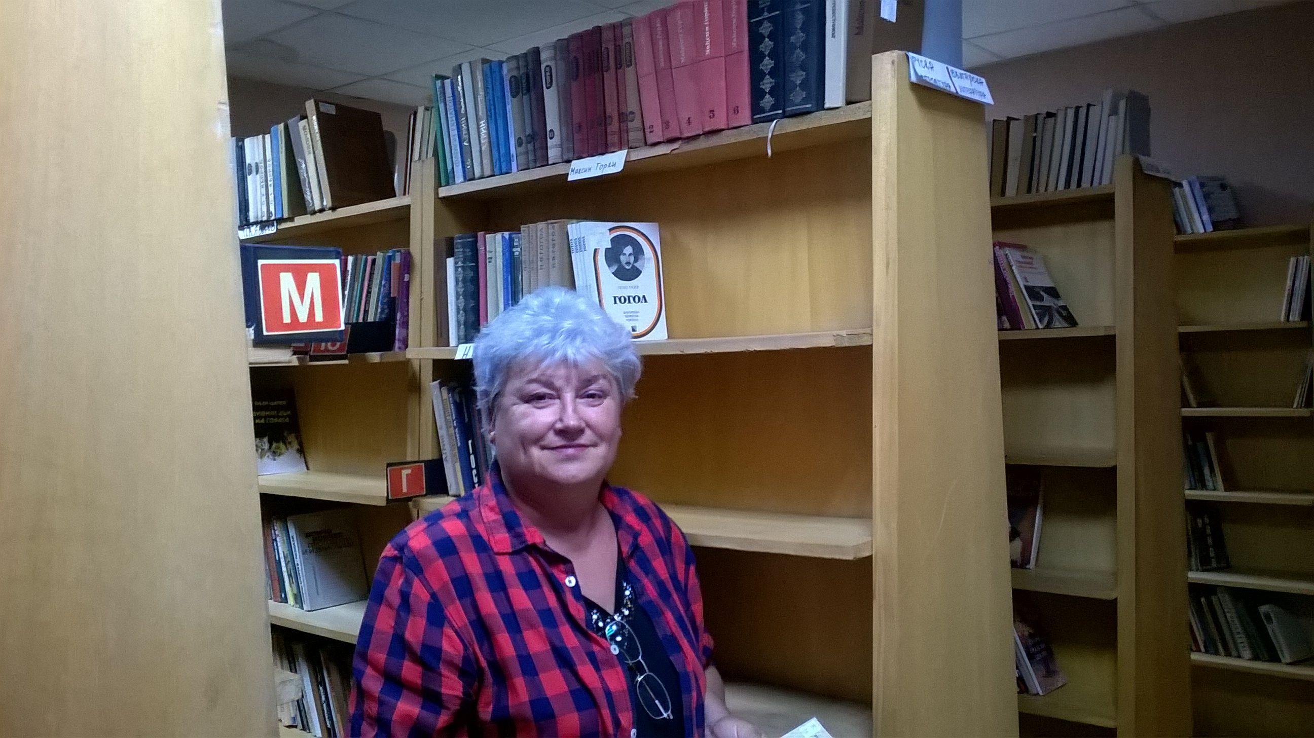 The librarian Maria Petkova Ivanova in the library of the Cultural Community Center [Chitalishte] 'Napredak' [Progress] in Chepintsi.