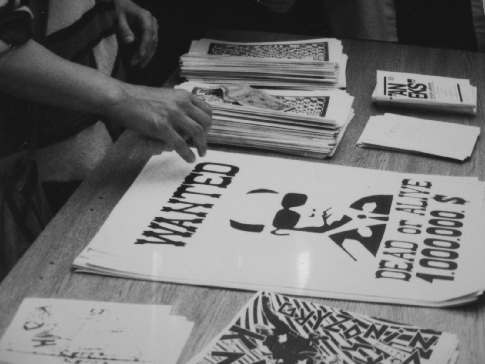 A scene from the happening 'The Day After' carried on Piotrkowska street in Łódź, June 06, 1989. Posters 'Wanted' by Krzysztof Raczyński are placed on the table for sale during the event.