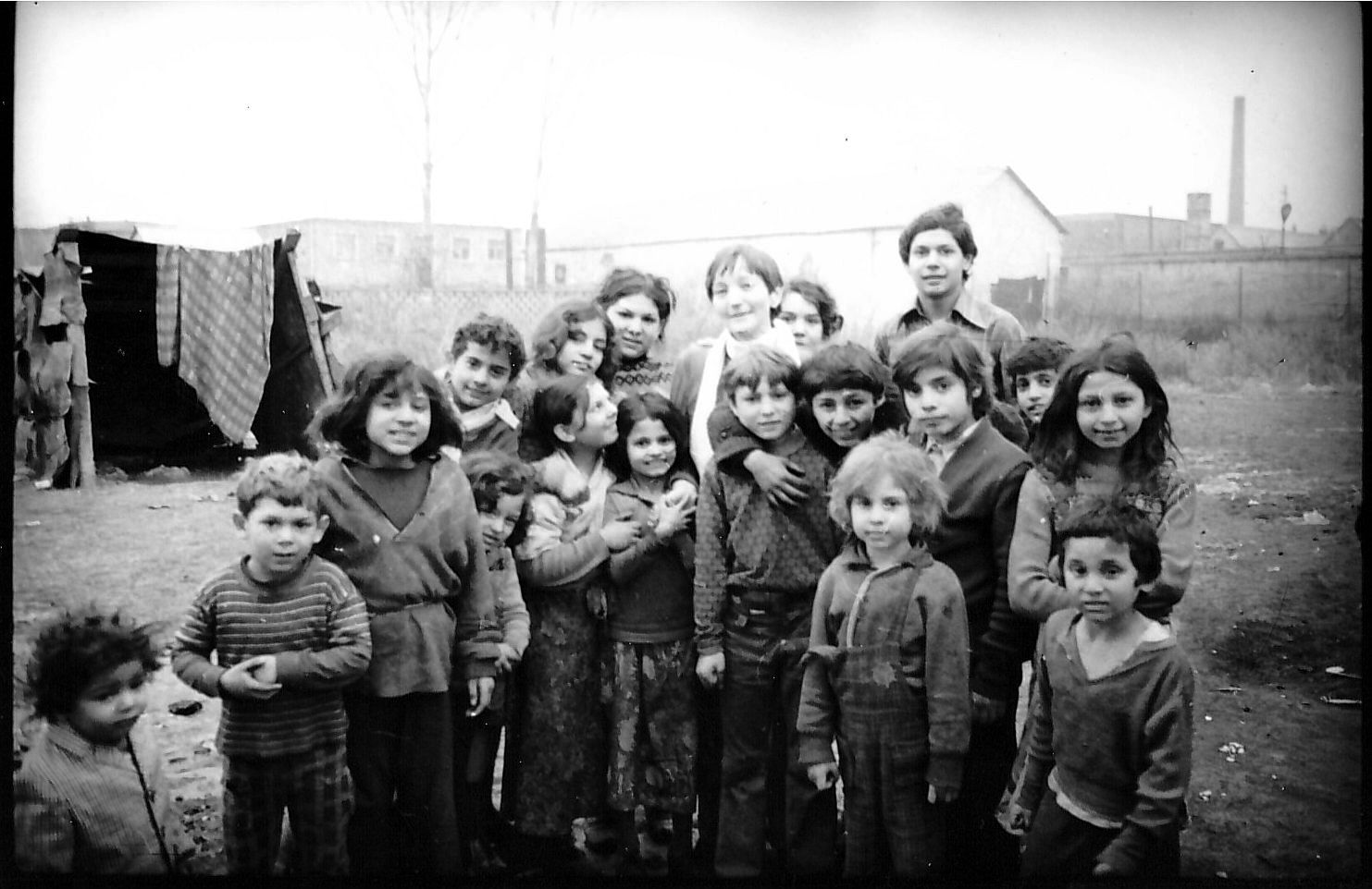 Children in a Gipsy colony in Esztergom-kertváros, Hungary, 1977Up in the middle can be seen sociologist Ottília Solt, who two years later founded SZETA together with seven friends.