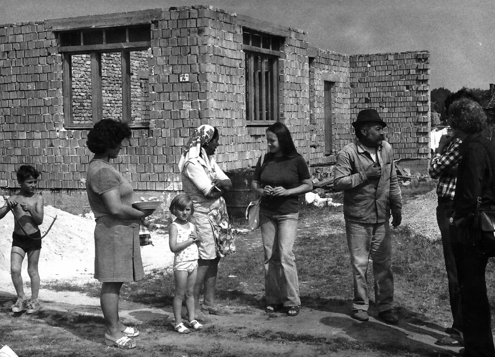 Sociologist Gabiella Lengyel as an activisit visiting countryside Roma families building their new homes by the support of SZETA in the village of Nógrádmegyer,Hungary 1981.