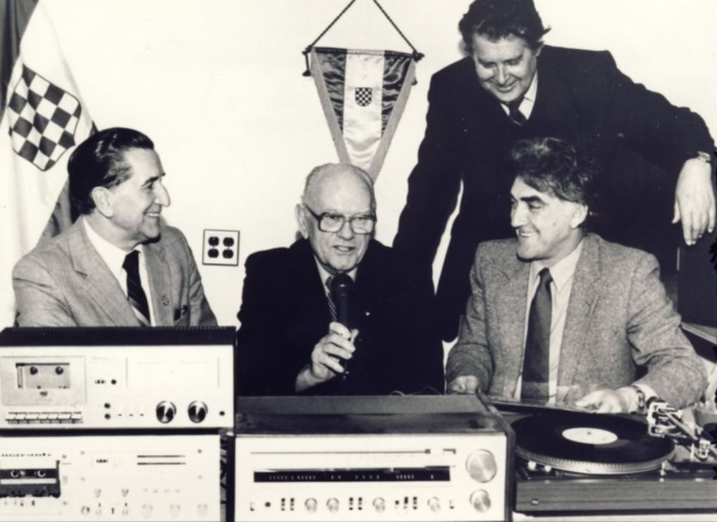 The picture shows the editorial staff of The Voice of Free Croatia sponsored by the Croatian Radio Club in New York, founded in 1969 and still on the air. From left Vinko Kužina, John (Ivan) Pintar (1904-1989), Kurnoslav Mašina (1904-1989) and behind them is Miro Gal.