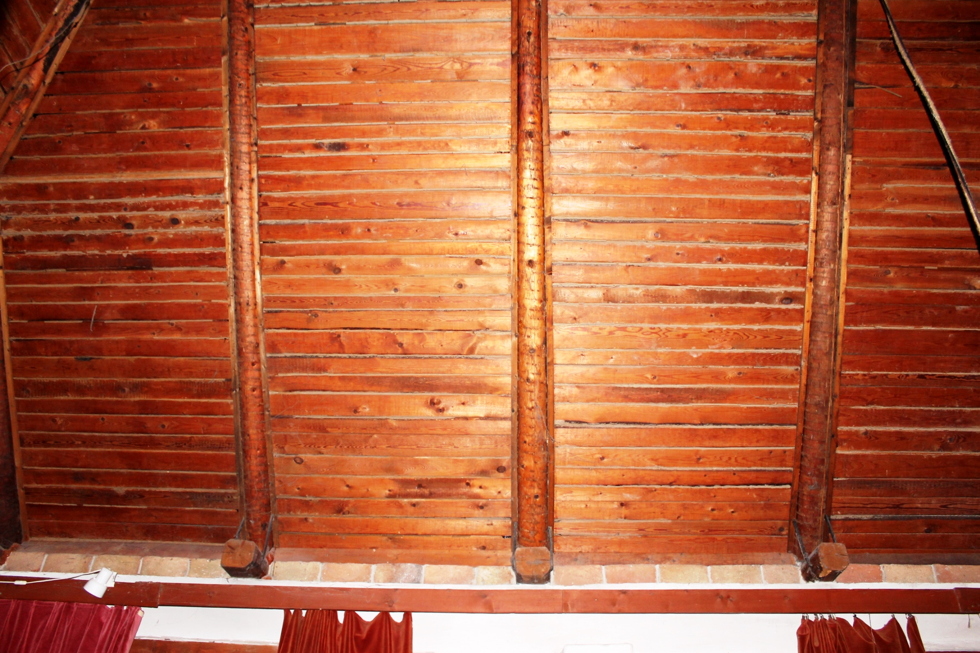 The wooden ceiling in the room named 'common'