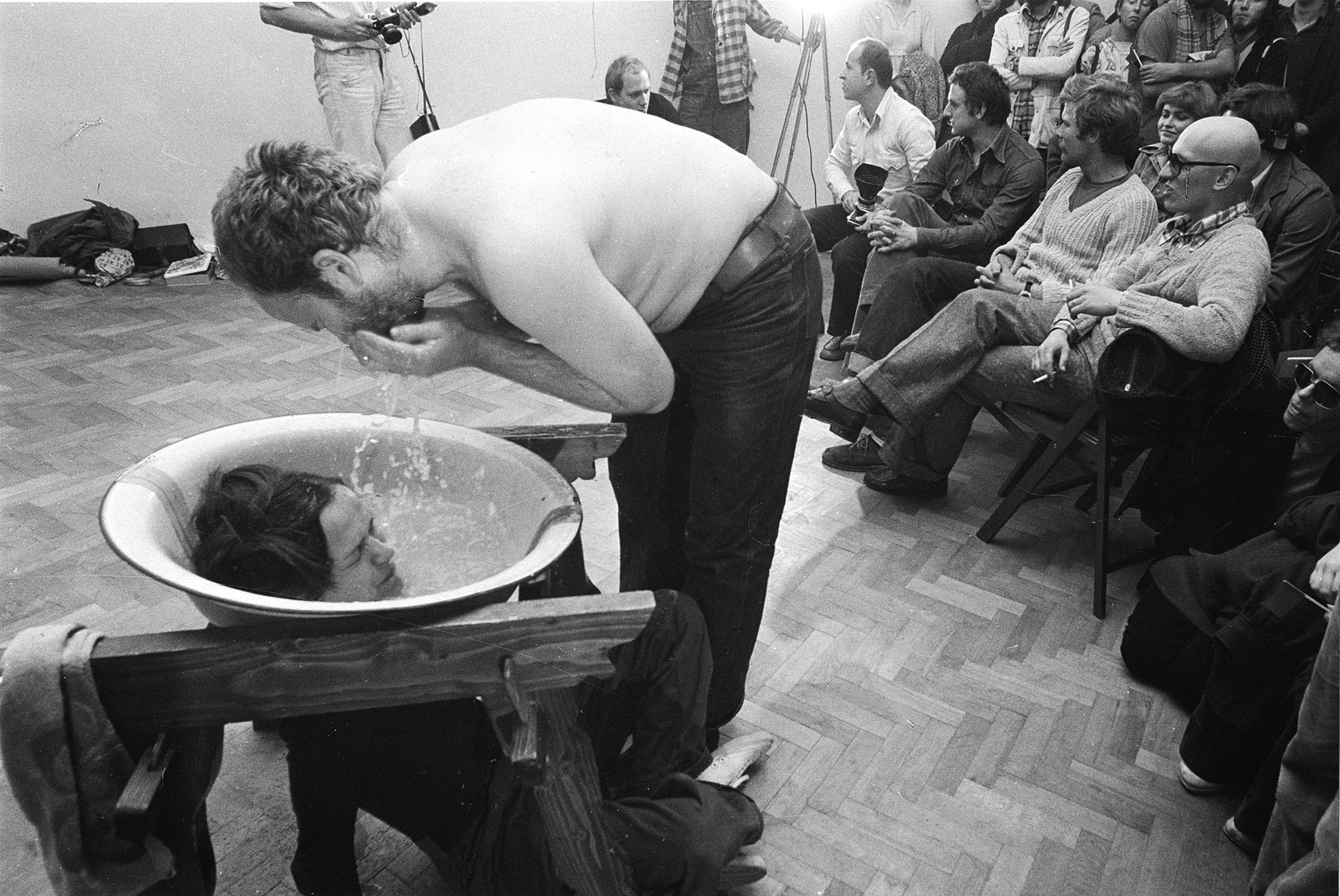 """KwieKulik """"Activities on the Head"""", performance in Labirynt galery, 1978, Lublin, Poland. Photo by Andrzej Polakowski."""