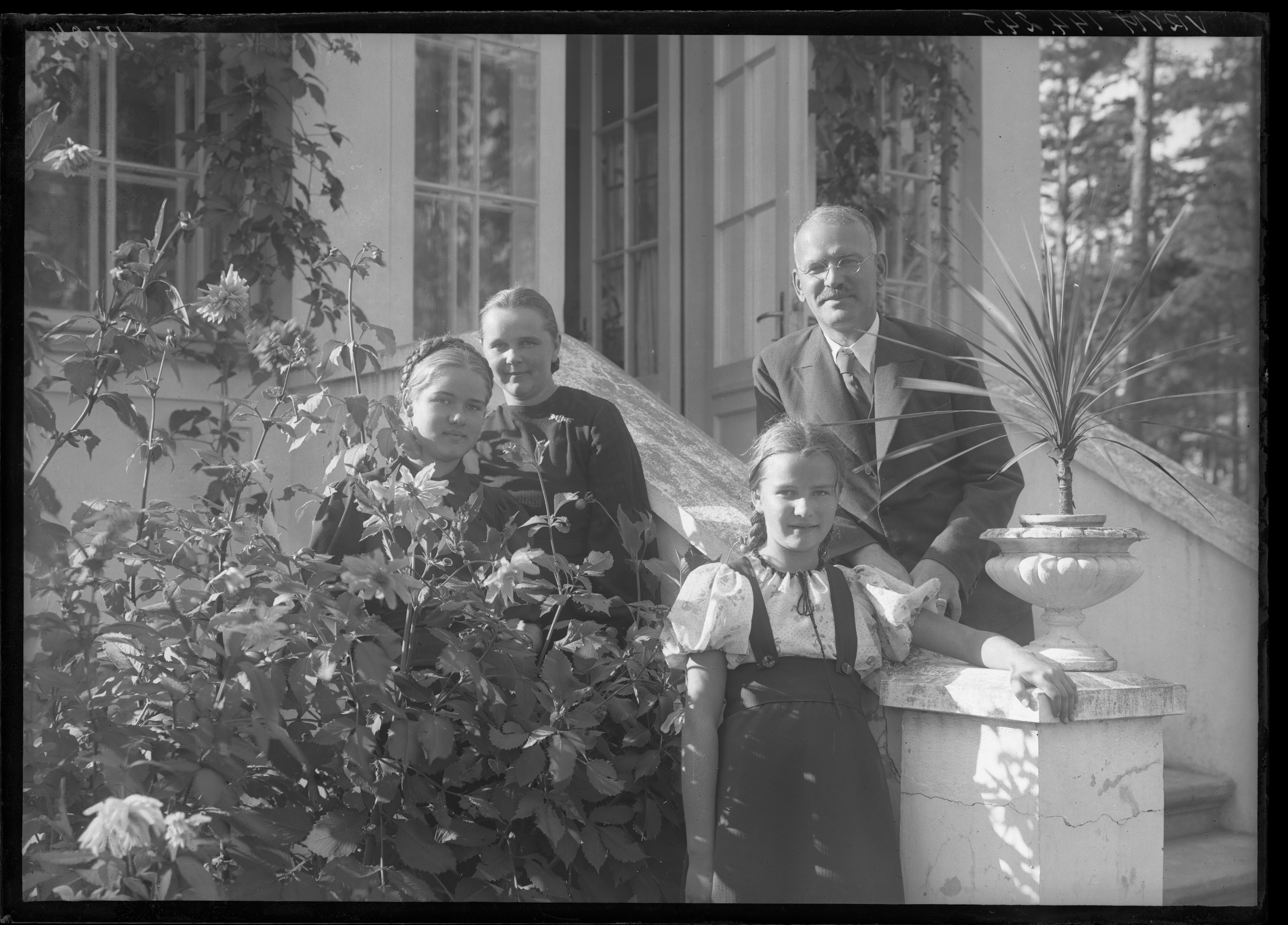 Portrait of philisopher, professor of Latvian University Pauls Dāle (1889-1968) with his family in front of their house in Mežaparks, Riga, taken by Krišs Rake in 1936. P. Dāle was a disciple of E. Husserl, the most prominent philosopher in the interwar Latvia, founder of the Institute of Psychology of the Latvian University in 1938. Due to his philosophic and religious thoughts P. Dāle was fired from the Latvian State University in 1948 and deprived from possibility to do academic research. Although 5 years later he was allowed to work at the Institute of Language and Literature of the Latvian SSR Academy of Sciences and later also earned living by translations from Russian. The last years of his life were spent in poverty and isolation. VRVM 144.245