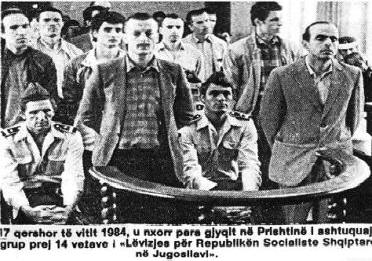 The photograph shows a group of fourteen people of The Movement for the Albanian Socialist Republic in Yugoslavia brought to trial in Pristina on 17 June 1984. The picture was published in an article by Sabile Keçmezi-Basha on the historical website Pashtriku (http://www.pashtriku.org/?kat=64&shkrimi=1263).