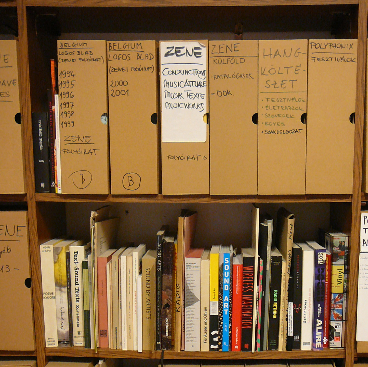 A bookshelf with general literature about sound poetry at Artpool Art Research Center.