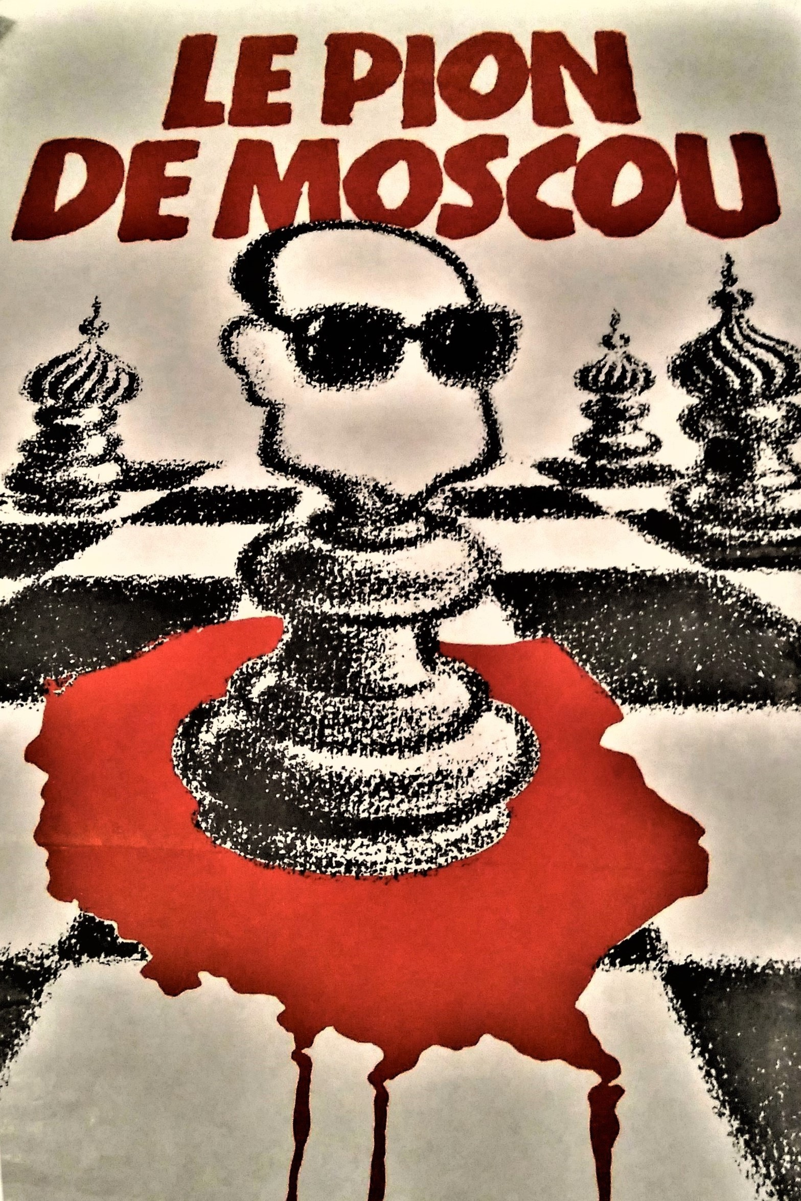 Le Pion De Moscou (A Pawn of Moscow) French poster depicts General Wojciech Jaruzelski, head of the authoritarian communist government of Poland, as a pawn on the chessboard. He is firmly placed on the bleeding map of the country. Jaruzelski whose face lacks a mouth, a feature which implies the absence of any free will, is accompanied by other pawns that resemble Kremlin's domes. In all likelihood, the poster was conceived during the martial law period which lasted from 13 December 1981 to 22 July 1983 and met with vehement protests in France.